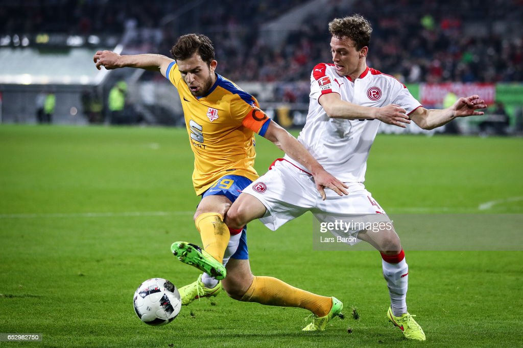 Julian Schauerte of Duesseldorf (R) and Ken Reichel of Braunschweig battle for the ball during the Second Bundesliga match between Fortuna Duesseldorf and Eintracht Braunschweig at Esprit-Arena on March 13, 2017 in Duesseldorf, Germany.