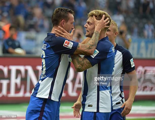 Julian Schieber and Alexander Esswein of Hertha BSC celebrate after scoring the 21 during the season beginning match between Hertha BSC and SC...