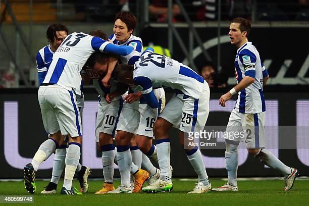 Julian Schieber of Berlin celebrates his team's third goal with team mates during the Bundesliga match between Eintracht Frankfurt and Hertha BSC at...