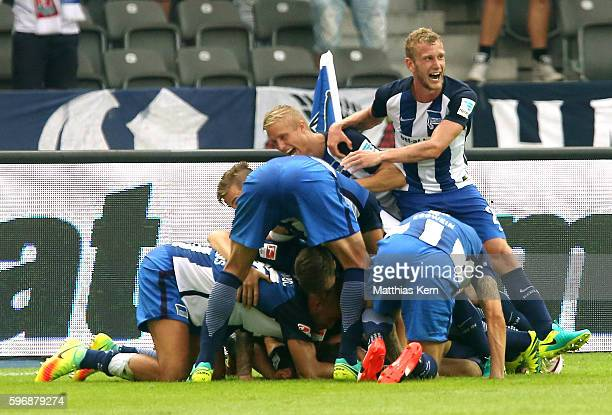 Julian Schieber of Berlin jubilates with team mates after scoring the third goal during the Bundesliga match between Hertha BSC and SC Freiburg at...