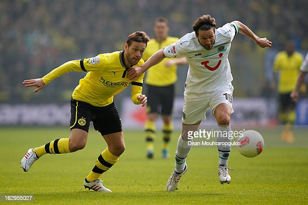 Julian Schieber of Dortmund and Christian Schulz of Hannover battle for the ball during the Bundesliga match between Borussia Dortmund and Hannover...