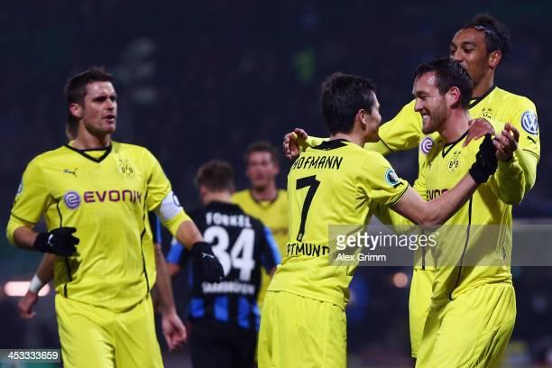 Julian Schieber of Dortmund celebrates his team's first goal with team mates Sebastian Kehl Jonas Hofmann and PierreEmerick Aubameyang during the DFB...