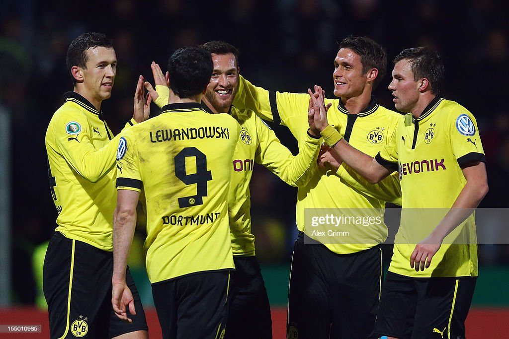 Julian Schieber (C) of Dortmund celebrates his team's fourth goal with team mates Ivan Perisic, Robert Lewandowski, Sebastian Kehl and Kevin Grosskreutz (L-R) during the second round match of the DFB Cup between VfR Aalen and Borussia Dortmund at Scholz-Arena on October 30, 2012 in Aalen, Germany.