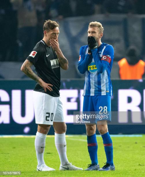 Julian Schieber of FC Augsburg and Fabian Lustenberger of Hertha BSC after the Bundesliga match between Hertha BSC and FC Augsburg at Olympiastadion...