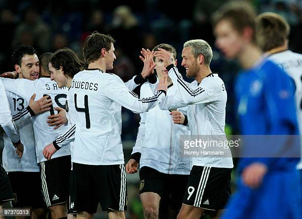 Julian Schieber of Germany celebrates with his teammates after scoring the second goal during the U21 Euro Qualifying match between Germany and...