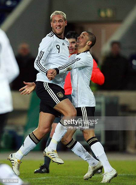 Julian Schieber of Germany celebrates with Sidney Sam after scoring the second goal during the U21 Euro Qualifying match between Germany and Iceland...