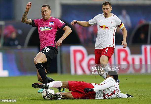 Julian Schieber of Hertha BSC is tackled by Bernardo of RB Leipzig during the Bundesliga match between RB Leipzig and Hertha BSC at Red Bull Arena on...