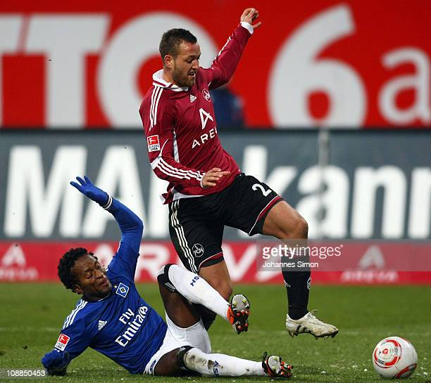 Julian Schieber of Nuernberg fights for the ball with Ze Roberto of Hamburg during the Bundesliga match between 1 FC Nuernberg and Hamburger SV at...