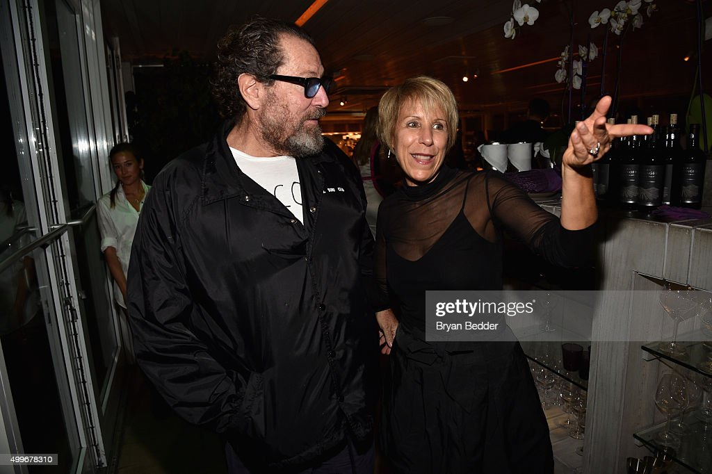 Julian Schnabel and Bonnie Clearwater attend the Vanity Fair And NSU Art Museum's Private Dinner Hosted By Bob Colacello And Bonnie Clearwater In Honor Of Douglas S. Cramer at Juvia on December 2, 2015 in Miami Beach, Florida.