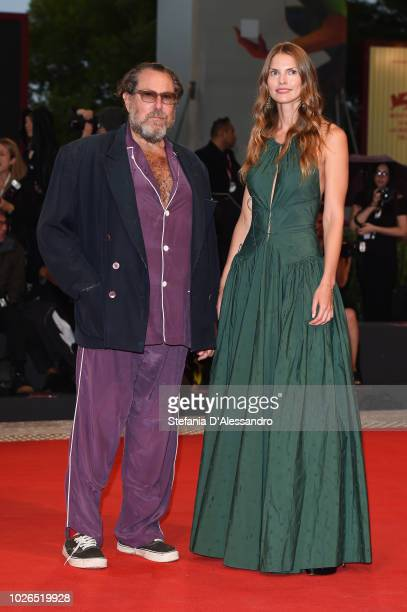 Julian Schnabel and Louise Kugelberg walk the red carpet ahead of the 'At Eternity's Gate' screening during the 75th Venice Film Festival at Sala...