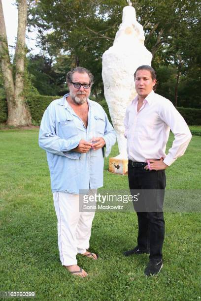 Julian Schnabel and Vito Schnabel at the LongHouse Reserve Summer benefit on July 20 2019 in East Hampton New York