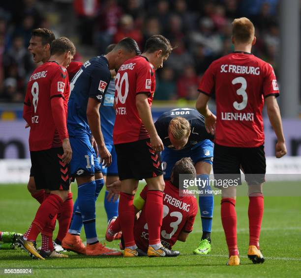 Julian Schuster of Freiburg argues with Kevin Vogt of Hoffenheim after a clash during the Bundesliga match between SportClub Freiburg and TSG 1899...