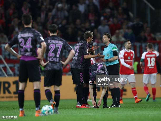 Julian Schuster of Freiburg gestures to referee Guido Winkmann during the Bundesliga match between 1 FSV Mainz 05 and SportClub Freiburg at Opel...