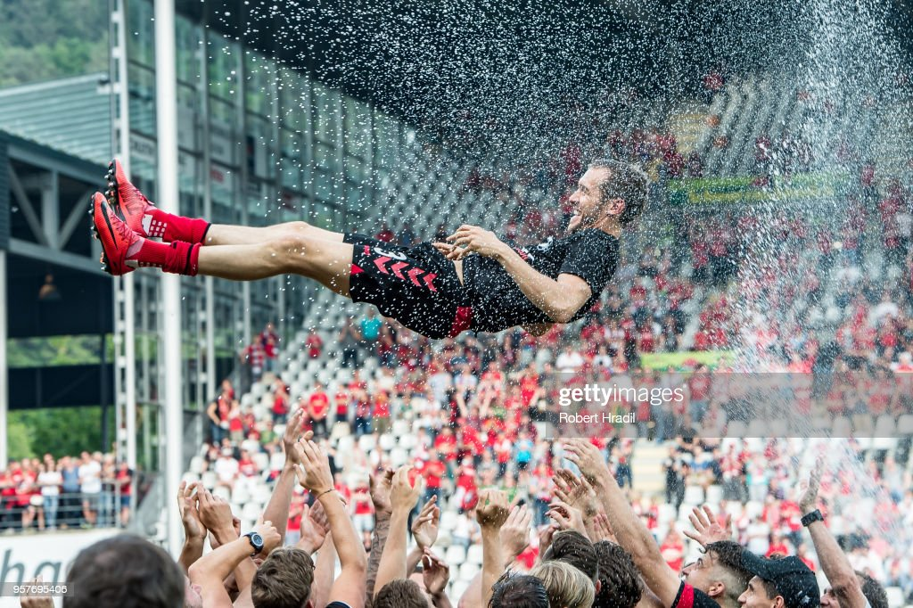 #23 Julian Schuster of Freiburg gets thrown in the air by his team mates during the Bundesliga match between Sport-Club Freiburg and FC Augsburg at Schwarzwald-Stadion on May 12, 2018 in Freiburg im Breisgau, Germany.