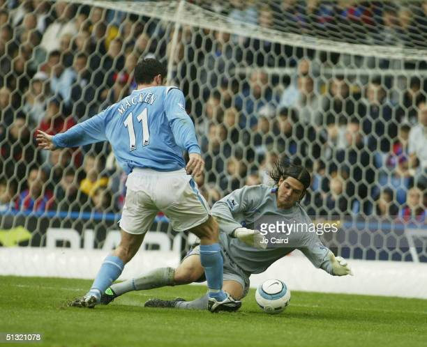 Julian Seroni makes a save from Jon Macken during the Barclays Premiership match between Crystal Palace and Manchester City at Selhurst Park on...