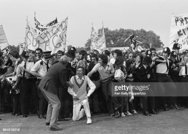 Julian Shackleton of Gloucestershire is helped through the crowd after the Benson and Hedges Cup Final between Gloucestershire and Kent at Lord's...