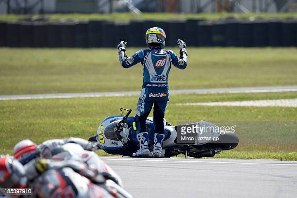 Julian Simon of Spain and and Italtrans Racing Team crashed out during the Moto2 race ahead of the Australian MotoGP which is round 16 of the MotoGP...