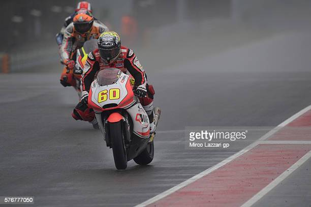 Julian Simon of Spain and QMMF Racing Team heads down a straight during the Moto2 race during the MotoGp of Germany Race at Sachsenring Circuit on...