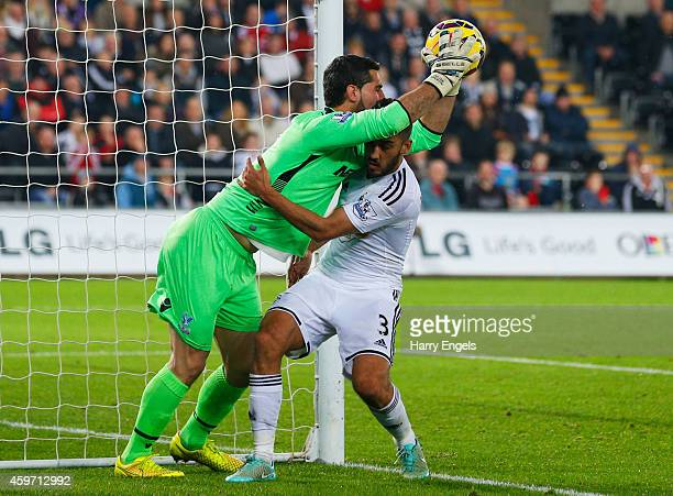 Julian Speroni of Crystal Palace catches the ball from Neil Taylor of Swansea City during the Barclays Premier League match between Swansea City and...