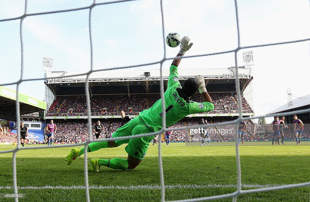 Julian Speroni of Crystal Palace saves a penalty from Scott Arfield of Burnley during the Barclays Premier League match between Crystal Palace and Burnley at Selhurst Park on September 13, 2014 in London, England.