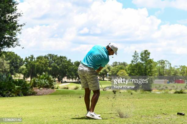 Julian Suri hits a tee shot on the 15th hole during the final round of an APGA Tour event on the Slammer Squire Course at World Golf Village on July...