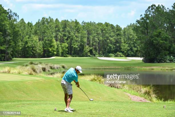 Julian Suri hits a tee shot on the 16th hole during the final round of an APGA Tour event on the Slammer Squire Course at World Golf Village on July...