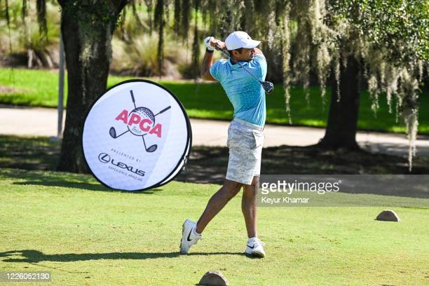 Julian Suri hits a tee shot on the first hole during the final round of an APGA Tour event on the Slammer Squire Course at World Golf Village on July...