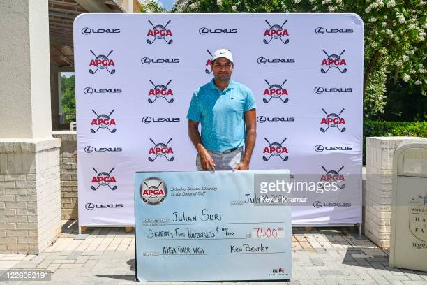 Julian Suri holds the winners check after his playoff victory during the final round of an APGA Tour event on the Slammer Squire Course at World Golf...