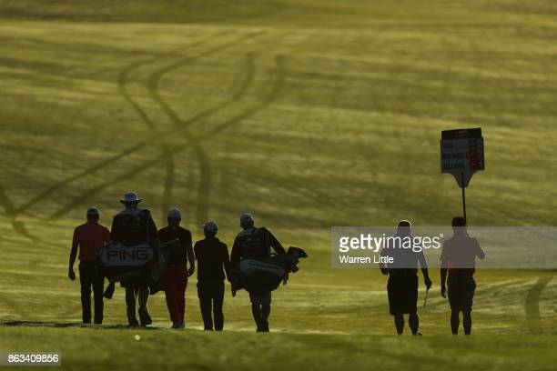 Julian Suri of the United States Andy Sullivan of England and Edoardo Molinari of Italy walk down the 11th hole during day two of the Andalucia...