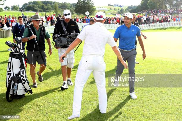 Julian Suri of the United States is congratulated by Matt Wallace of England on his victory on the 18th green during the final round of Made in...