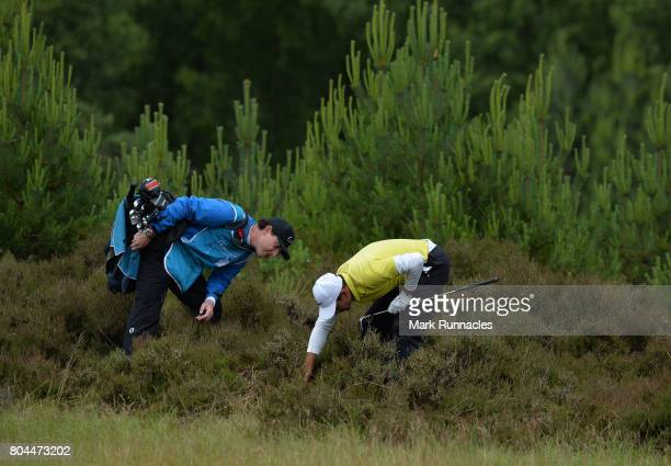 Julian Suri of USA looks for his ball at the 9th hole in deep rough during the second day of the 2017 SSE Scottish Hydro Challenge hosted by...