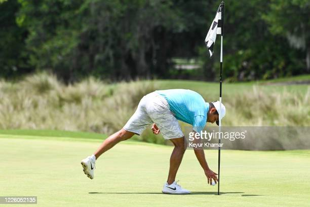 Julian Suri takes his ball out of the cup after holing out for birdie during the final round of an APGA Tour event on the Slammer Squire Course at...