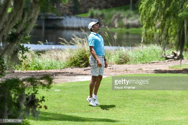 Julian Suri watches as his chip shot goes in for birdie during the final round of an APGA Tour event on the Slammer Squire Course at World Golf...
