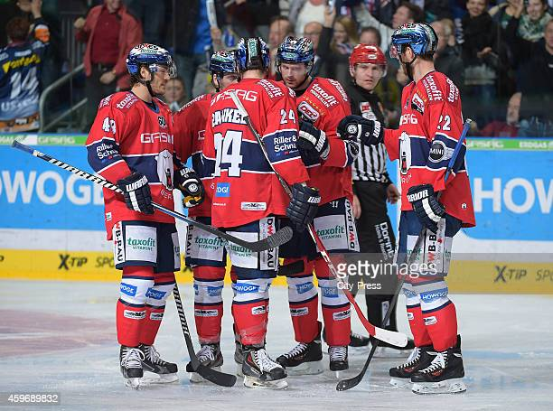 Julian Talbot, Jens Baxmann, Andre Rankel, Jimmy Sharrow and Barry Tallackson of the Eisbaeren Berlin celebrate after scoring the 3:2 during the game...