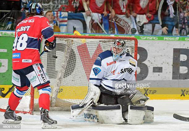 Julian Talbot of the Eisbaeren Berlin scores a goal against Timo Pielmeier of ERC Ingolstadt during the game between Eisbaeren Berlin and ERC...