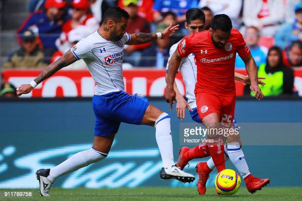 Julian Velazquez of Cruz Azul struggles for the ball with Pedro Canelo of Toluca during the 4th round match between Toluca and Cruz Azul as part of...