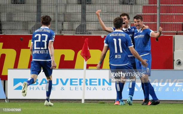 Julian Weigel of Magdeburg celebrates the second goal with teammates during the 3. Liga match between Hallescher FC and 1.FC Magdeburg at Erdgas...