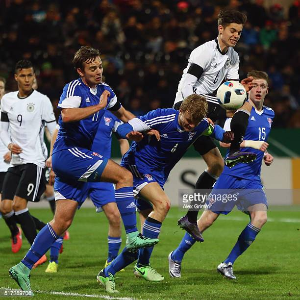 Julian Weigl 8top of Germany is challenged by Gestur Dam Andrias Eriksen and Teit Jacobsen of Faroe Islands during the 2017 UEFA European U21...