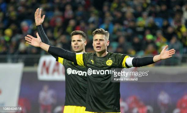 Julian Weigl and Lukasz Piszczek of Dortmund reacts during the Bundesliga match between RB Leipzig and Borussia Dortmund at Red Bull Arena on January...