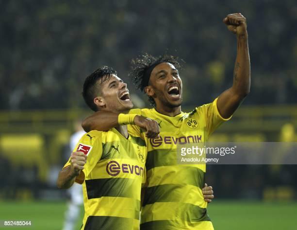 Julian Weigl and PierreEmerick Aubameyang of Borussia Dortmund celebrate after scoring a goal during the Bundesliga soccer match between Borussia...