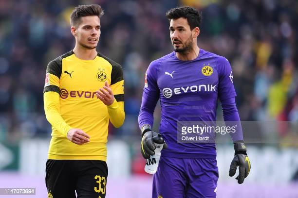 Julian Weigl and Roman Buerki of Borussia Dortmund speaks during the Bundesliga match between SV Werder Bremen and Borussia Dortmund at Weserstadion...