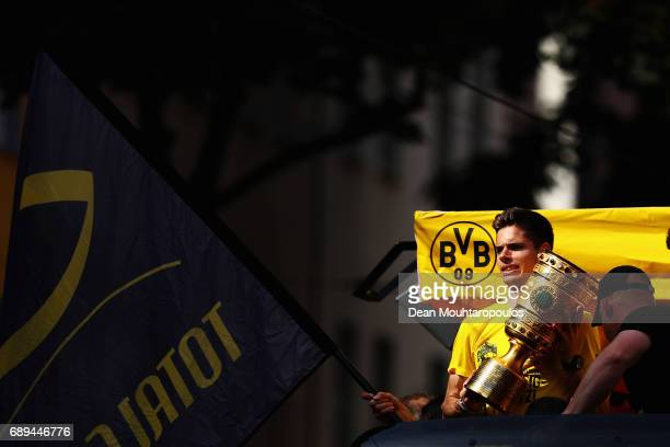 Julian Weigl celebrates on the bus during a parade near Borsigplatz for the celebrations of Borussia Dortmund's DFB Cup win on May 28, 2017 in...