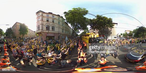 Julian Weigl celebrates on the bus with the trophy during a parade near Borsigplatz for the celebrations of Borussia Dortmund's DFB Cup win on May 28...