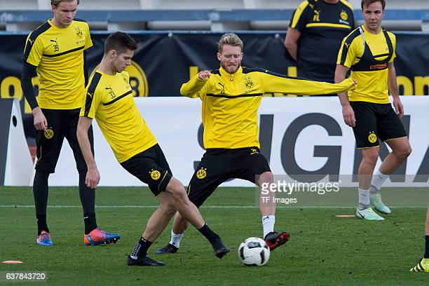 Julian Weigl of Borussia Dortmund and Andre Schuerrle of Borussia Dortmund battle for the ball during the second day of the training camp at Estadio...