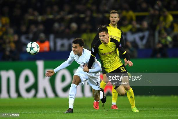 Julian Weigl of Borussia Dortmund and Dele Alli of Tottenham Hotspur in action during the UEFA Champions League group H match between Borussia...