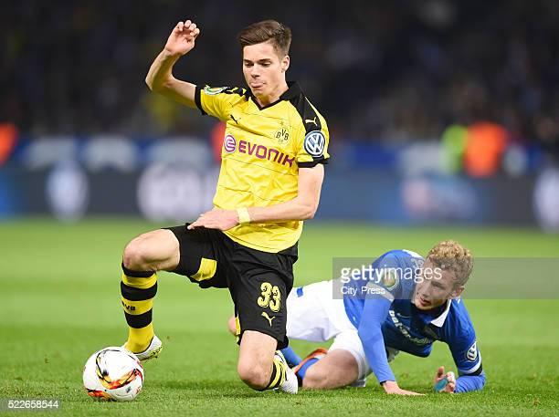 Julian Weigl of Borussia Dortmund and Fabian Lustenberger of Hertha BSC during the match between Hertha BSC and Borussia Dortmund at Olympiastadion...