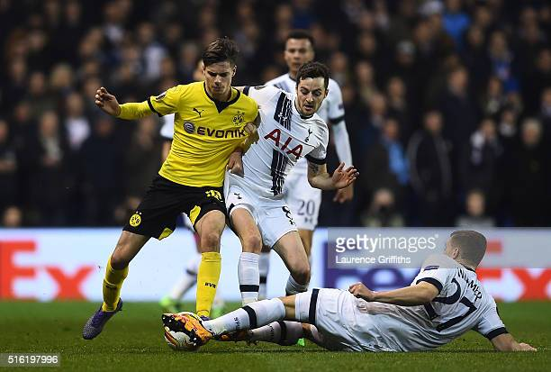 Julian Weigl of Borussia Dortmund battles with Ryan Mason and Kevin Wimmer of Tottenham Hotspur during the UEFA Europa League round of 16 second leg...