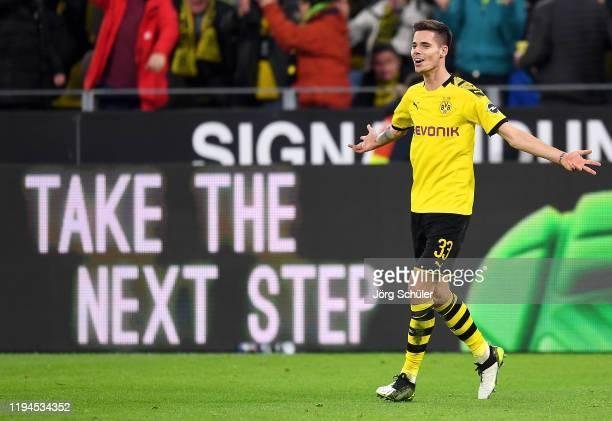 Julian Weigl of Borussia Dortmund celebrates after scoring his team's first goal during the Bundesliga match between Borussia Dortmund and RB Leipzig...