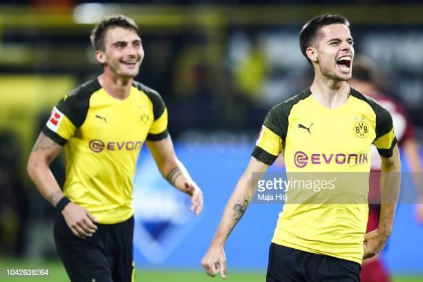 Julian Weigl of Borussia Dortmund celebrates with Maximilian Philipp of Borussia Dortmund after scoring a goal to make it 70 during the Bundesliga...
