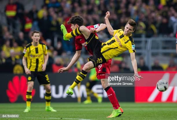 Julian Weigl of Borussia Dortmund challenges Kai Havertz of Leverkusen during the Bundesliga match between Borussia Dortmund and Bayer 04 Leverkusen...